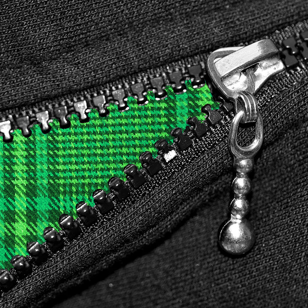 Black top zipping over a green tartan material